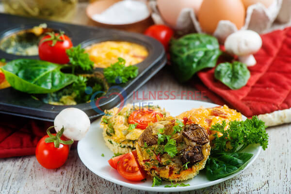 Breakfast Egg muffins recipe with ham cheese spinach out of the oven